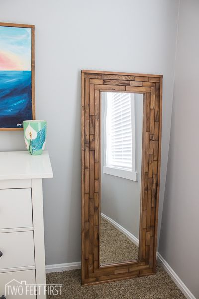 Make a cheap mirror look so much better with a wood shim frame