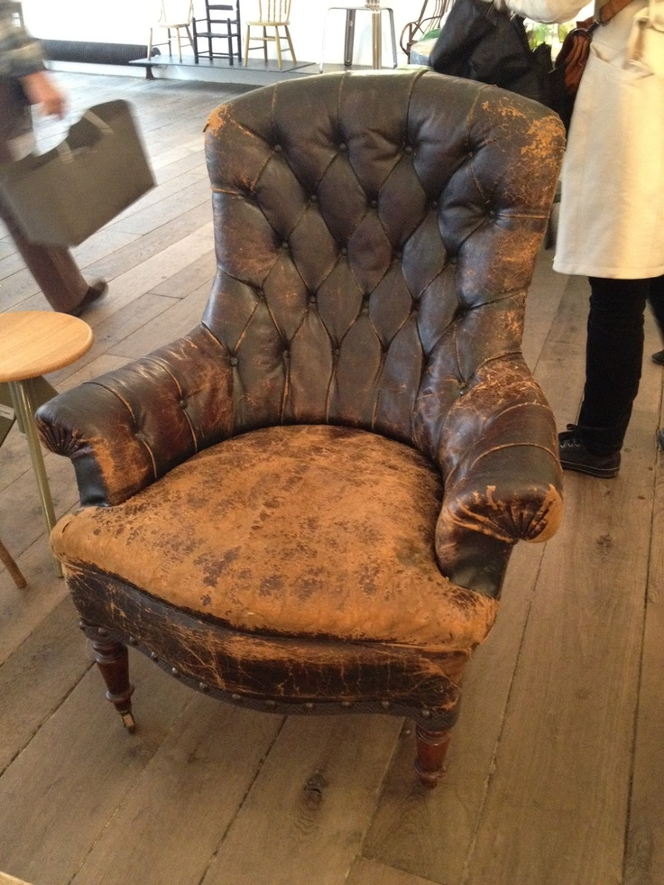 Wonderful antique leather chair at Merci Paris via vignette design