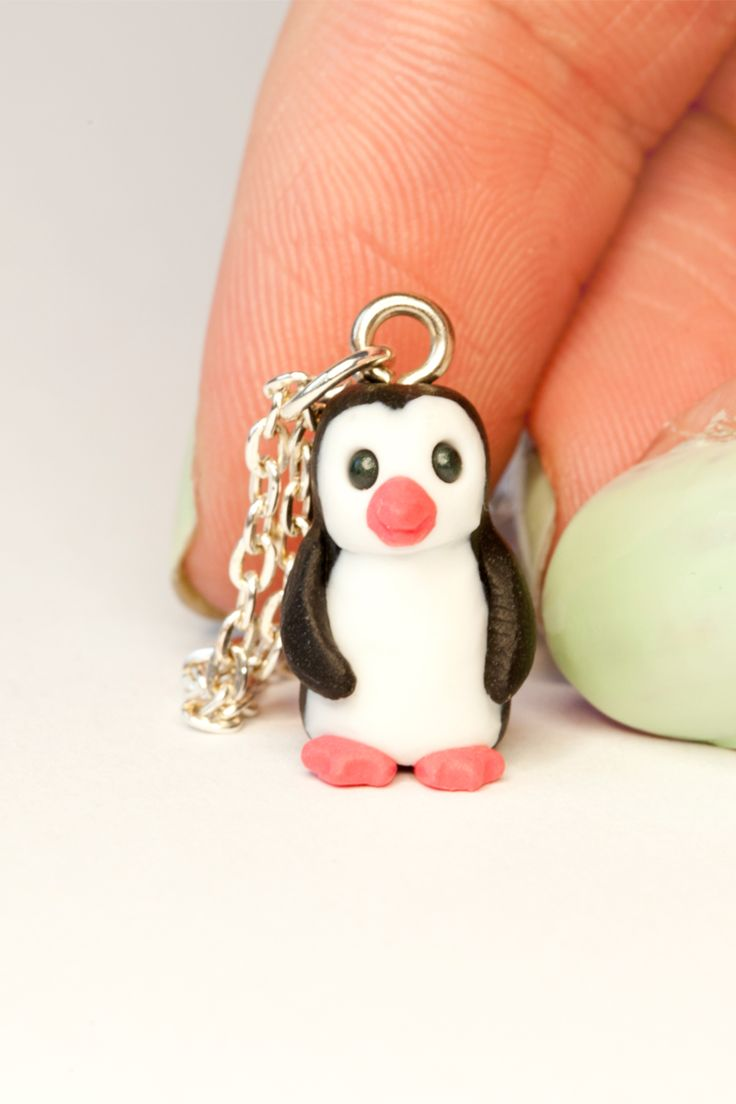 A miniature penguin charm necklace.    This tiny penguin is smiling happily, just perfect for adoption by any penguin lover.    All the creatures are lovingly handmade from polymer clay by Gizzys Gifts including the delicate details on the mouth, nose and textures. So no two characters are exactly alike so each miniature pet has its own individual personality - making them very easy to fall in love with!