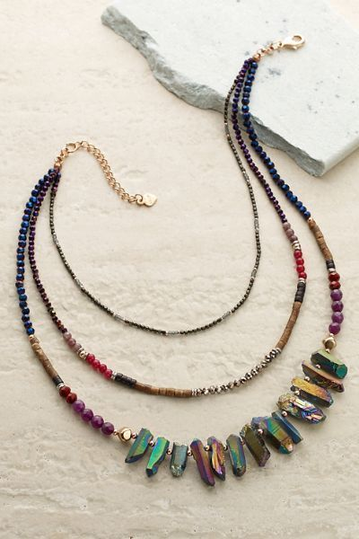 Our Sandrine Necklace has an irregular collection of shimmering Czech crystals. It looks beautiful with any color because of the natural tones of the beads.