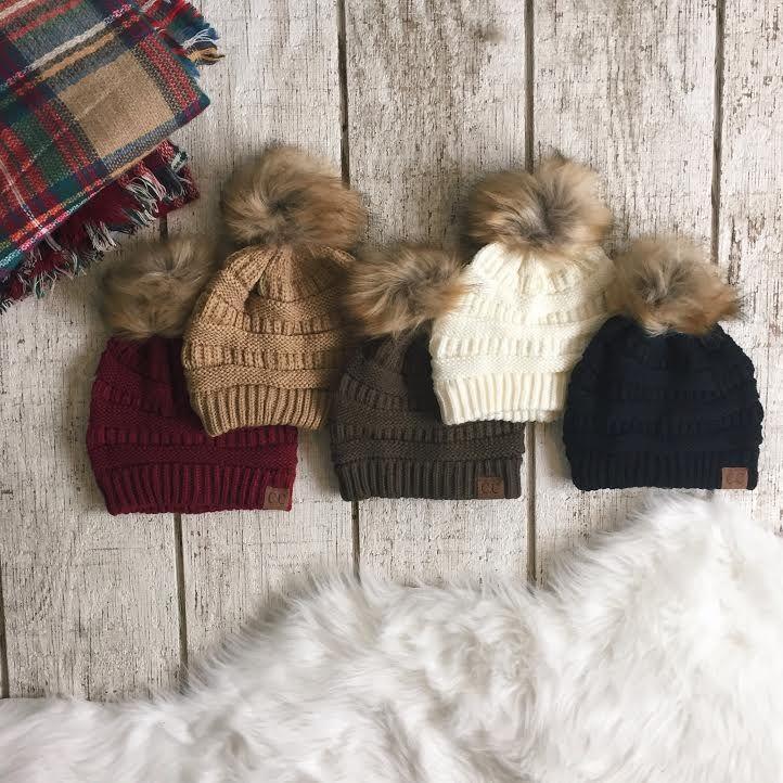 Top off your winter wardrobe in warm, fuzzy style! ❄️ #ShopImpressions #BeanieBeautiful #CozyCute