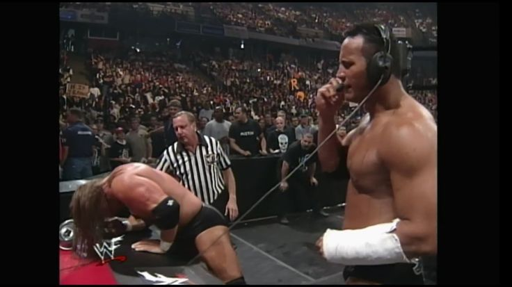 The Rock on the headset against Triple H at Over The Edge (1999)
