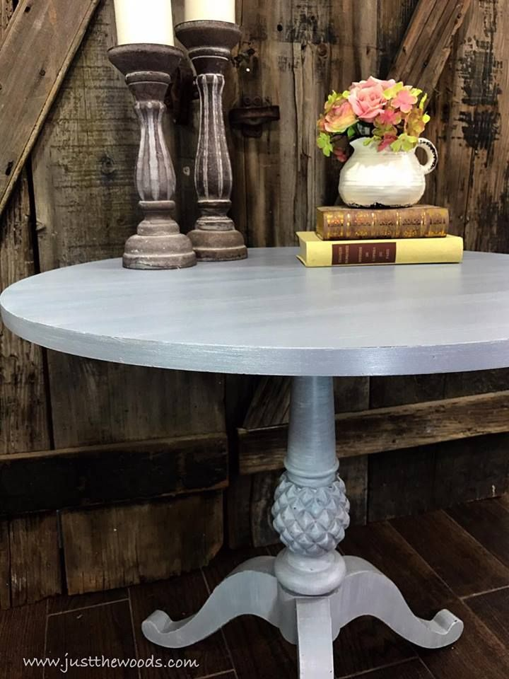 Just the Woods shares a painted pineapple pedestal table makeover, including repairing a chewed and damaged portion of wood.