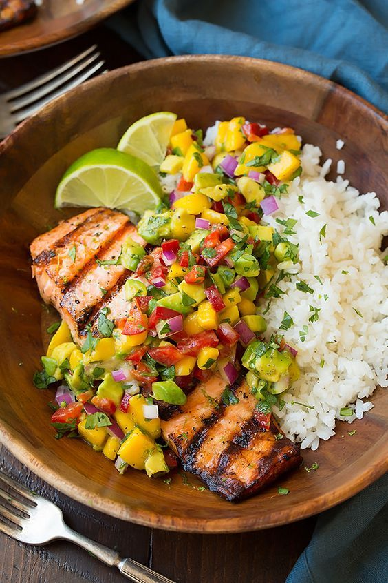 Grilled Lime Salmon with Avocado-Mango Salsa and Coconut Rice Serves 4.Here you have one of the ultimate summer meals! #recipe