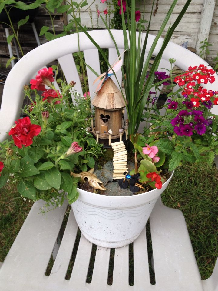Fairy garden with deck and motorcycle
