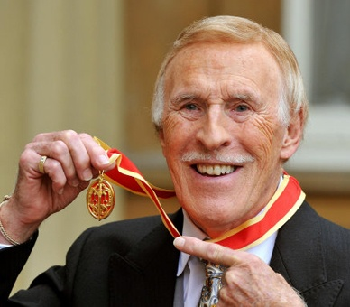 Sir Bruce Forsyth, veteran British entertainer, with his Knighthood for services to entertainment and charity after it was presented to him by The Queen during an Investiture ceremony at Buckingham Palace , London , 12 October 2011.
