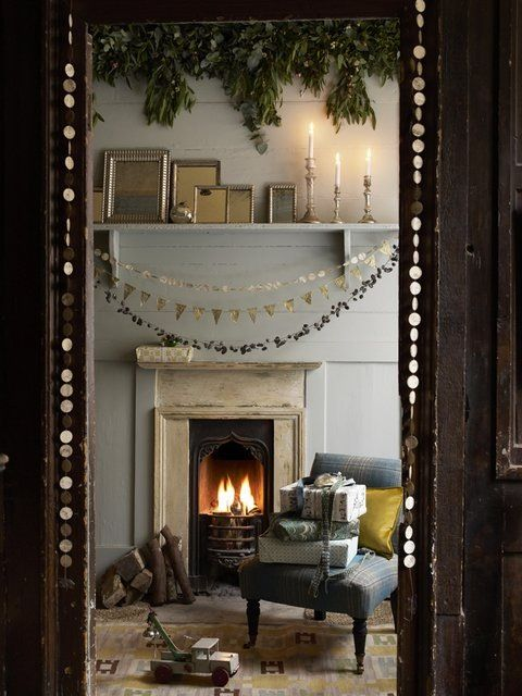 Christmas decor by fireplace with gold garland