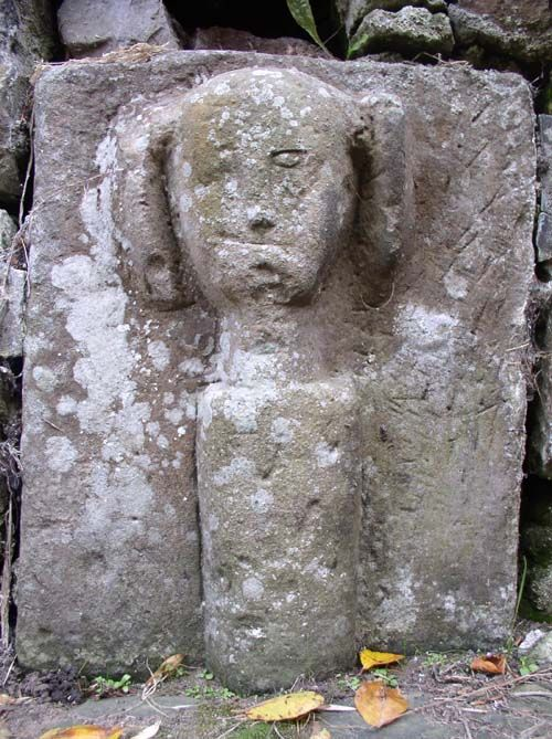Rostherne Celtic Head hair or horns?A close up of the Celtic Head in Rostherne Churchyard. Reputedly pulled out of Rotherne mere, near Knutsford, Cheshire, England.