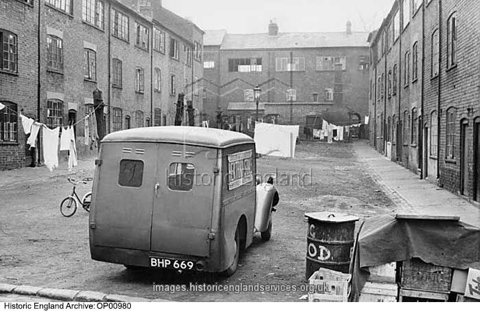 OP00980 GENERAL VIEW WITHIN COURT SHOWING DELIVERY VAN IN FOREGROUND.  NOTES ON REAR OF PRINT GIVE THE FOLLOWING ADDRESS: HORFORD PLACE, ALBION STREET, WEAVER COURT  Date1953 Photographer: Jm Prest