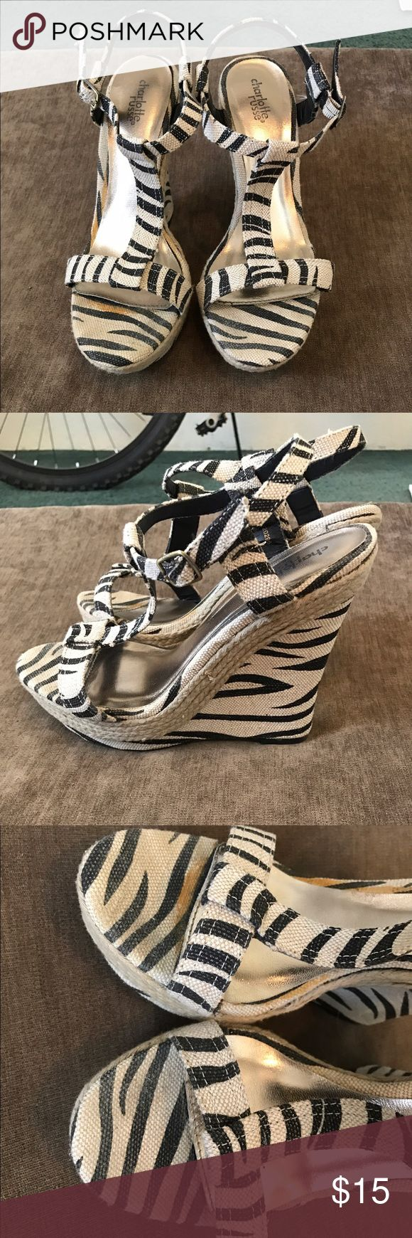 Zebra stripe wedges Only worn a couple times. Some discoloration on the toe because of the type of fabric Charlotte Russe Shoes Wedges