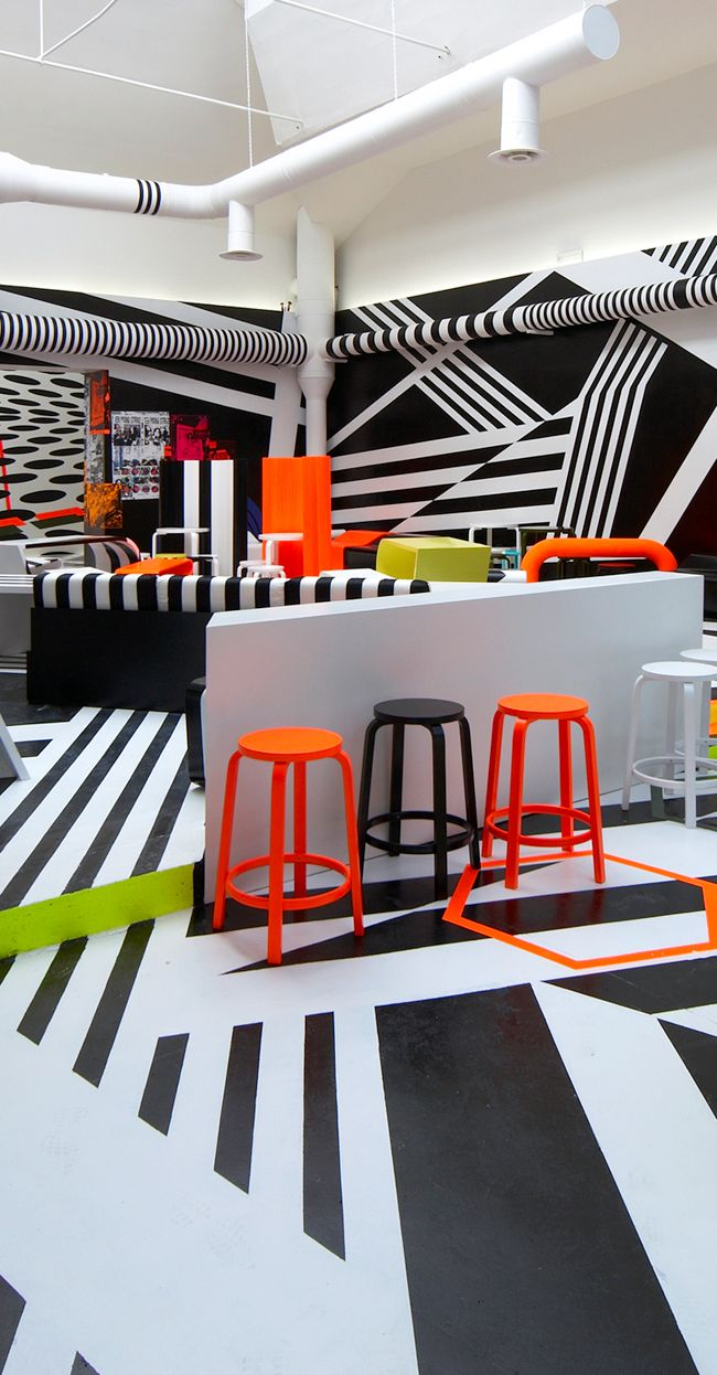 Venice Biennial Cafe, Italy    by Tobias Rehberger  2009 - the use of striking colour in contrast to the black and white graphics allows for a much more pleasurable experience - it is less of an assault on the eye.