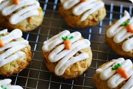 culinaryconfessional: Easy Carrot Cake Cookies 1 pkg carrot cake mix 8 oz canned crushed pineapple, drained 2 carrots, finely shredded 1 tsp ginger, grated 2 eggs 2 tbsp vegetable oil 1 cup pecans, toasted and chopped 16 oz store-bought cream cheese frosting Non-stick cooking spray Preheat oven to 350-deg. Coat two large baking sheets with the non-stick spray. In the bowl of an electric stand mixer fitted with a flat paddle, combine the cake mix, pineapple, carrots, ginger, eggs, and oil…