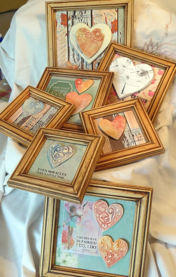 Fairy frames I had a bunch of old frames saved up & came across rub-on transfers, so I sanded down the frames and created these mixed media frames by using different ceramic & wooden elements that I had