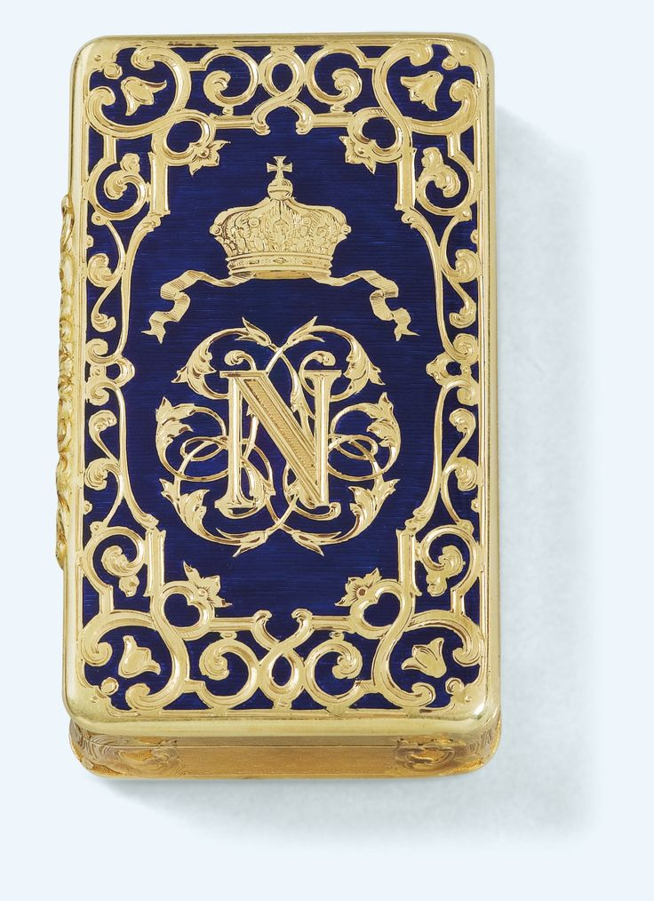 A GOLD AND ENAMEL PRESENTATION SNUFF BOX, LOUIS-FRANCOIS TRONQUOY, 1848-1851, rectangular, the lid engraved with the cypher of the future Napoleon III below a princely crown within strapwork on a translucent blue ground, the sides and base engine-turned within further strapwork, maker's mark, French 3e titre post-1838, the rim engraved for G. Lemonnier, joailler de Mgr Le Prince President, numbered:953 - Long. 8 cm ; 3 1/8 in