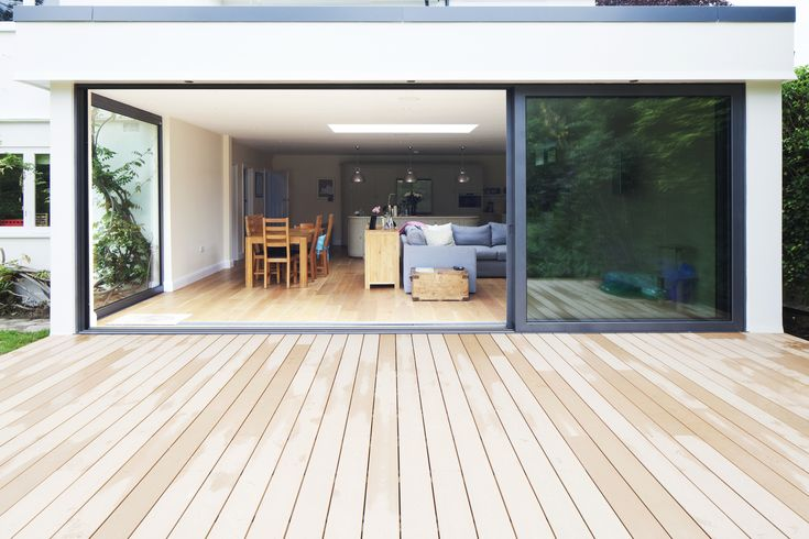 Modern rear flat roof extension | Large sliding aluminium doors | Level threshold | Patio decking | Corner glazing | Brighton Architects