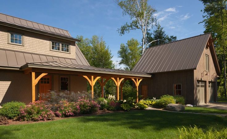 Traditional farmhouse exterior colors exterior traditional with brown metal roof wood front door beige shingle siding