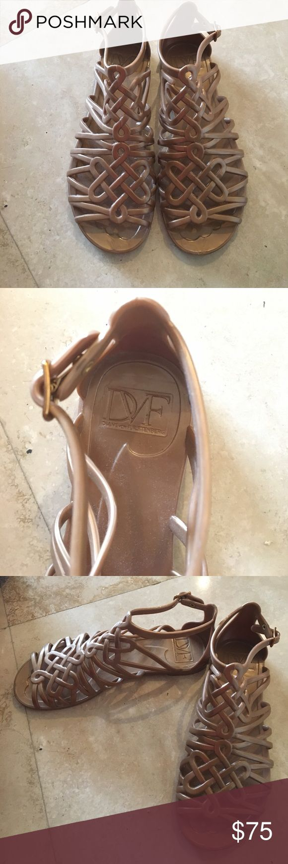 DVF gold flat sandals. Gently worn. Strappy and flat DVF sandals. You can adjust the strap to fit your foot. Gently worn and in good condition. Diane von Furstenberg Shoes Sandals