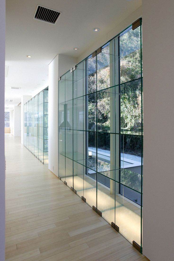 Front view luxury tropical house design 27 east sussex lane by ong - Contemporary Villa Interior Design Overlooking The Sea Transparent Glazed Window In White Painted Wall