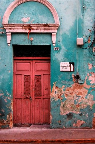 Merida, Mexico - The outside of these homes never looks like much..... oh but just wait till you open those doors. It's magic what the craftsmen can do.