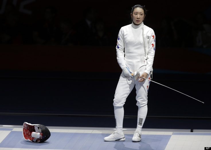But Time Was Up!  South Korea's Shin A-lam waits for a ruling by officials during a women's individual epee fencing semifinals match against Germany's Britta Heidemann at the 2012 Summer Olympics, Monday, July 30, 2012, in London.     (AP Photo/Dmitry Lovetsky)