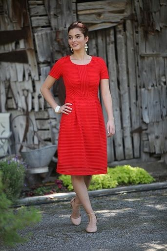 Stand out in RED! The Scarlett midi dress with sleeves, from Omika.