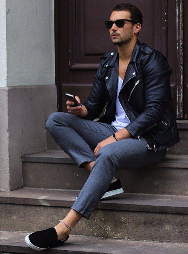 Black leather jacket / White t-shirt / Gray pants / Black sneakers