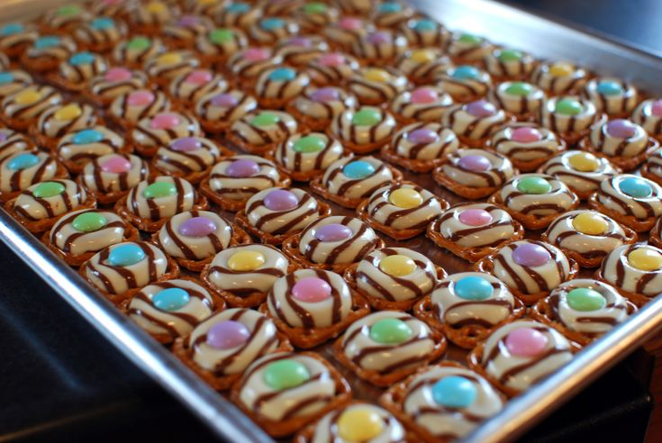 Perfect Easter Treat!  These are so addicting. . . you've been warned!!    Place the pretzels on greased baking sheet; place a chocolate hug in the center of each pretzel. Bake at 275 for 2-3 minutes or until chocolate is softened. Remove from the oven. Place an M on each, pressing down slightly. Refrigerate for 5-10 minutes or until chocolate is firm. Store at room temperature.