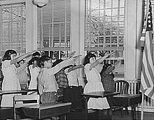 Bellamy salute - The salute described by Francis Bellamy, to accompany the American Pledge of Allegiance, which he had authored.  During the 1920s and 1930s, Italian fascists and Nazis adopted a salute which had the same form, resulting in controversy over the use of the Bellamy salute in the United States. It was officially replaced by the hand-over-heart salute when Congress amended the Flag Code on December 22, 1942.