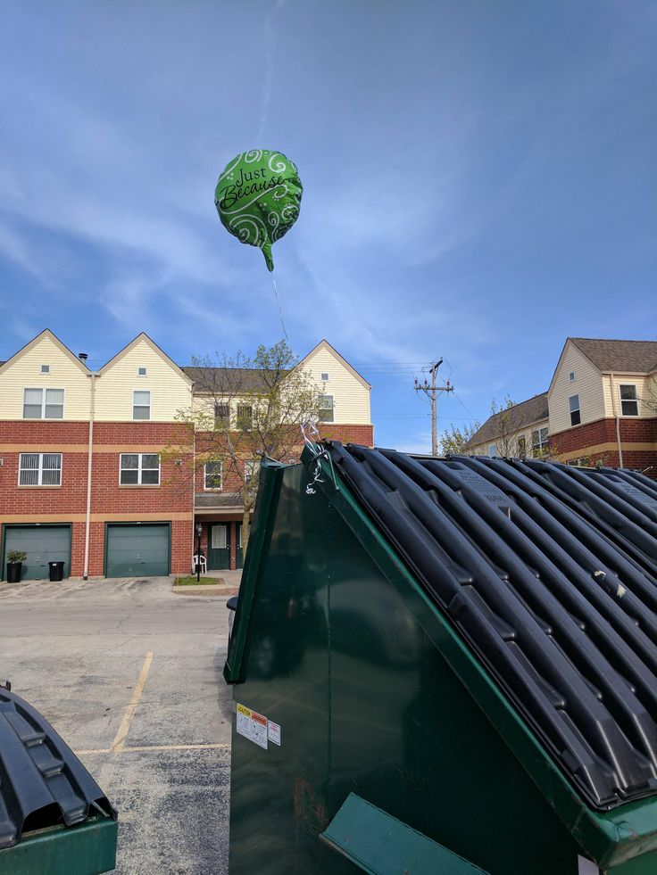 Why is there a balloon attached to that garbage dumpster?