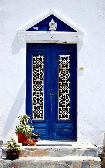 Love the rich cobalt blue of these doors. The white iron details really pop!