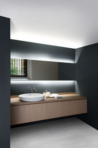 """Spoon XL, 2005 - Benedini Associati    The Spoon XL washbasin features generous measurements while retaining a minimalist yet enveloping elegance. Here too the two versions available, for installation on a top or semi recessed, allow different composition solutions to be created.  Dimensions cm 63,8 x 49p x 20,9h 25""""1/8 x 19""""1/4 x 8""""1/4. Weight 17 kg - 37,5 lb"""