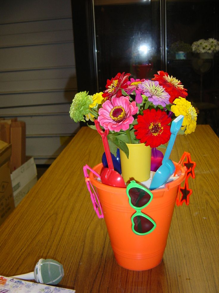 Beach party simple bucket centerpiece with sunglasses