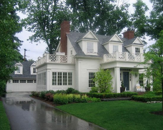 Churchill Cottage, gray room, cream siding, Chippendale railing around sunroom, detached garage