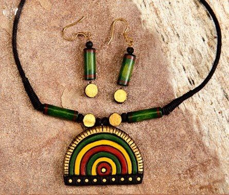 Half circle shaped handmade terracotta jewelry is painted in colors green, yellow , red, gold https://www.facebook.com/KavisTerracottajewellery