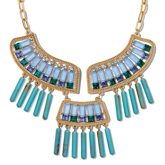 """Goldtone bib style statement necklace with faux stones, beads, and rhinestones in turquoise, light blue and dark blue.· Necklace: 17"""" L with Lobster Claw clasp· Extender: 3 1/2"""" L· Imported"""