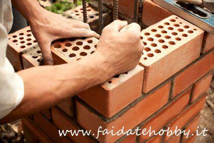 costruire un muro di mattoni
