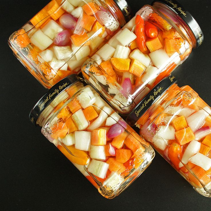 Acar - Indonesian raw vegetables pickle with cucumbers, carrots, shallots, and Thai chilies <3