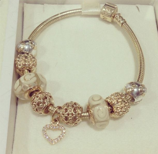 beautiful Gold & White Pandora bracelet! Hearts and floral