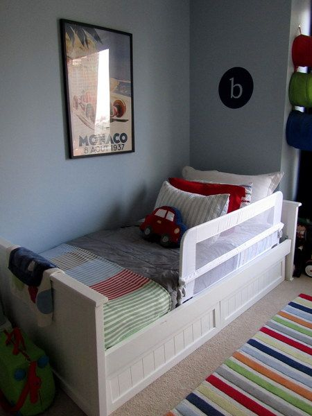Love the grey walls with blue, green & red theme