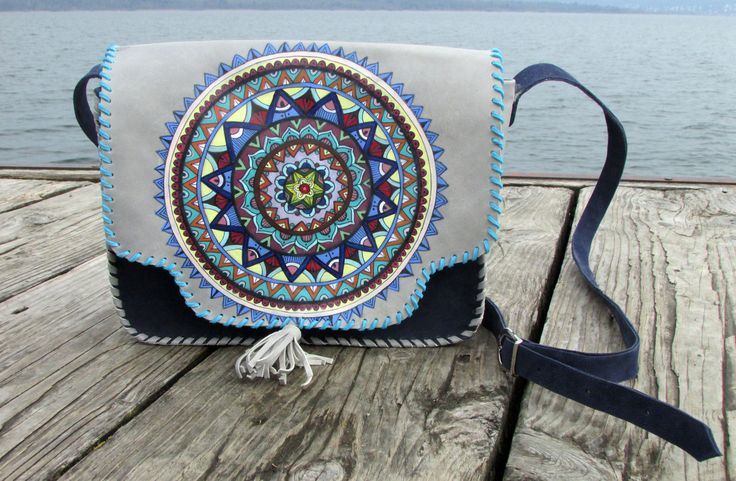 """""""Blue Mandala"""" Handmade leather bag made from two types of leather ,with painted mandala.The painting ist made with special colours for leather. #handmade #leatherbag #art #leathercraft #paintingonleather  #mandala #colours"""