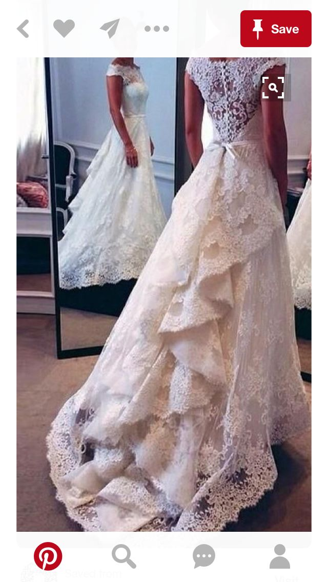 Wedding dress with layers of lace.