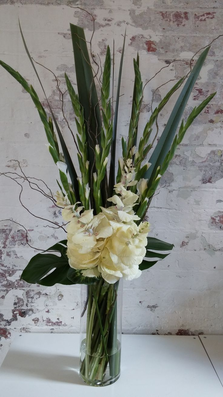 LARGE arrangement featuring gladioli, kale, flax, willow and monstera.
