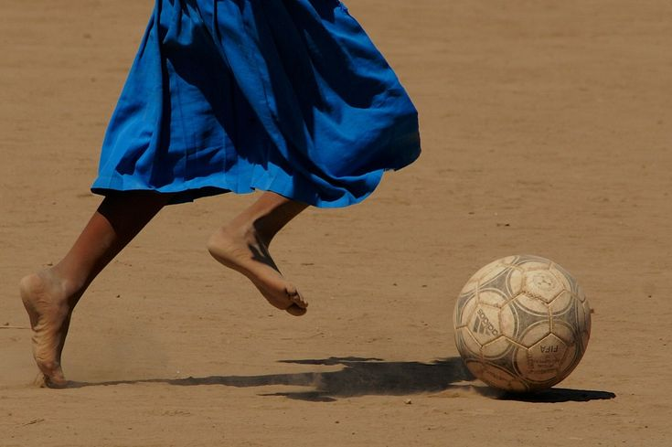 Girl playing football after school in Awasa, Ethiopia.