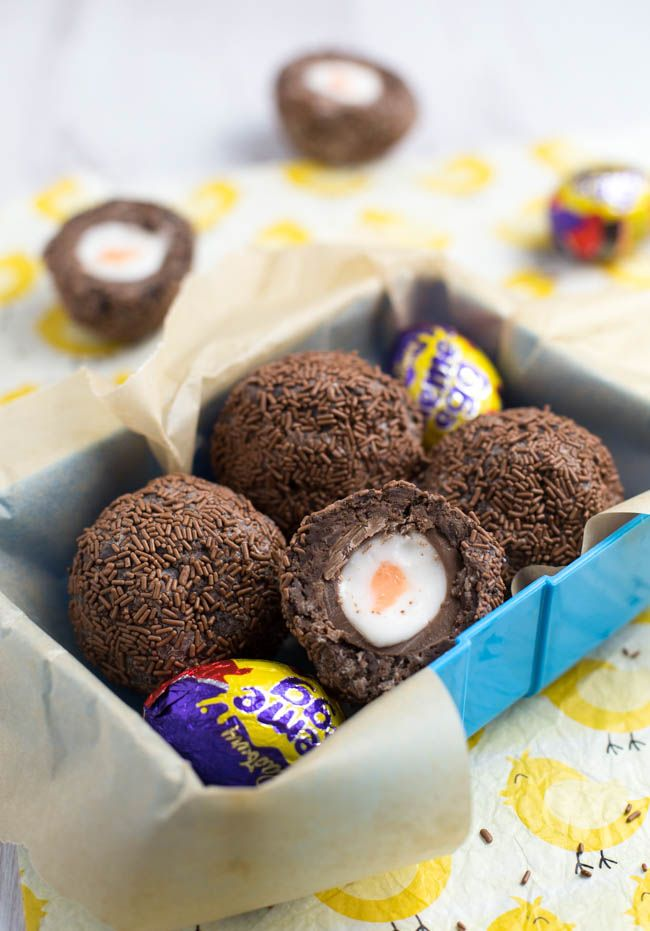 Scotch Creme Eggs... omg. Cadbury Creme Eggs covered in chocolate brownie and rolled in sprinkles. Sinfully delicious!!! Click for the full recipe!
