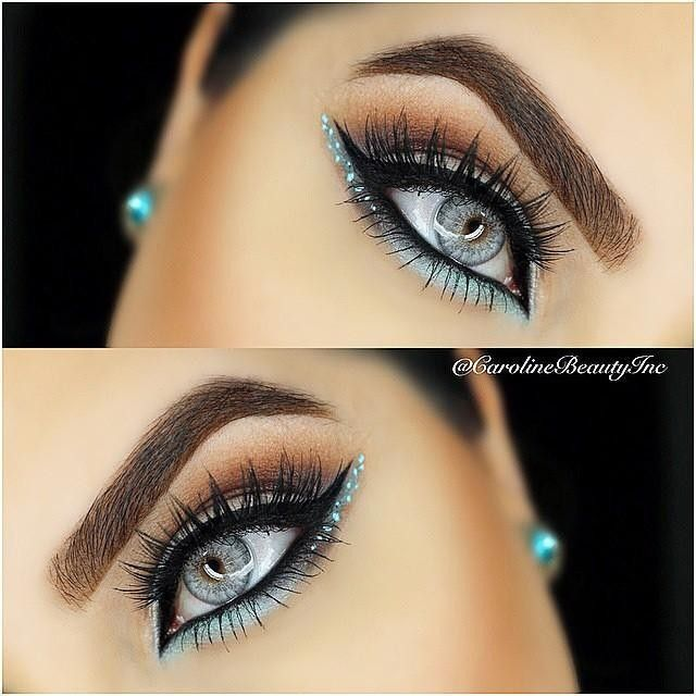 @carolinebeautyinc is rocking a strong winged liner look with a touch of blue  She used our Super Skinny Eye Marker in 'Carbon Black' for the precise wing. Recreate this look with our NEW Prismatic Shadow in 'Mermaid'! || #nyxcosmetics #regram