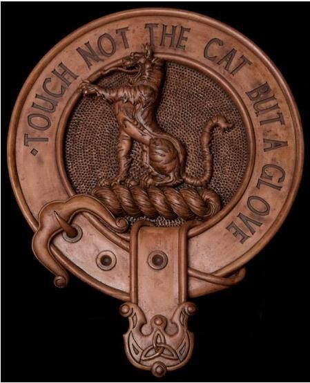 Clan Macpherson Motto: Touch not the cat bot a glove. 'Bot' means without. The 'glove' of a wildcat is the pad. If the cat is 'ungloved', its claws are unsheathed. The motto serves as a warning that one should beware when the wildcat's claws are 'without a glove'. It is a reference to the historically violent nature of the clan and serves as a metaphorical warning to other clans that they should think twice before interfering with Macpherson business.
