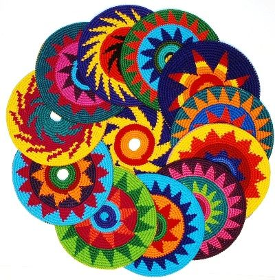 Crochet Frisbee - Interesting. I'm thinking Roxi would destroy it in no time, but perhaps it could be made with grocery bags a bit more durable?