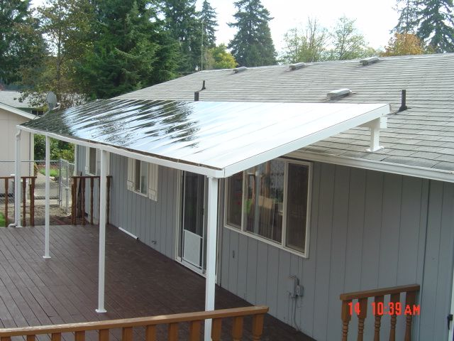 Is There A Way To Improve The Appearance Of A Covered Front Porch Roof That  Uses Corrugated Plastic Roof Panels?