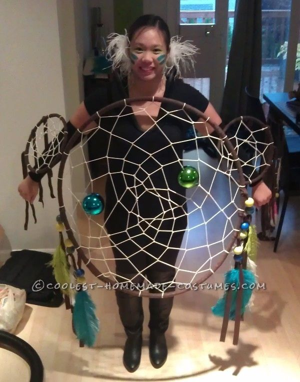 this is a dream catcher costume but the dream catcher itself could also be art hung on the wall or in a window or open archway & there is a picture tutorial on how to make it - she used irrigation tubing for the frame but says you could also use a hula hoop - plus  this is the perfect size to have if you have BIG dreams! :D :D :D