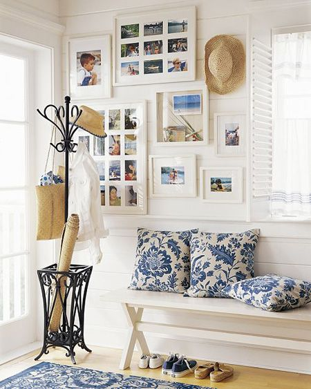 Cottage Entrance with Family Portrait Gallery Wall...from Small Place Style blog